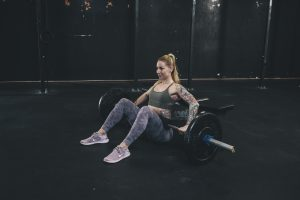 Woman setting up for a hip thrust at the gym